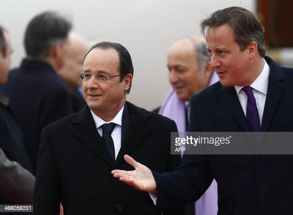 Britain's Prime Minister David Cameron introduces dignitaries to France's President Francois Hollande at RAF Brize Norton near Oxford in central...