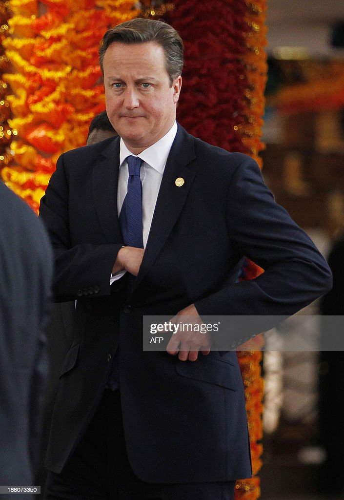 Britain's prime minister David Cameron looks on as he waits to participate in the official photograph following the opening ceremony of the Commonwealth Heads of Government Meeting (CHOGM) in Colombo on November 15, 2013. Sri Lanka's president urged his peers not to pass judgment over his country's past as he hosted a Commonwealth summit that threatens to be upstaged by a visit to the war-torn north by Britain's David Cameron.