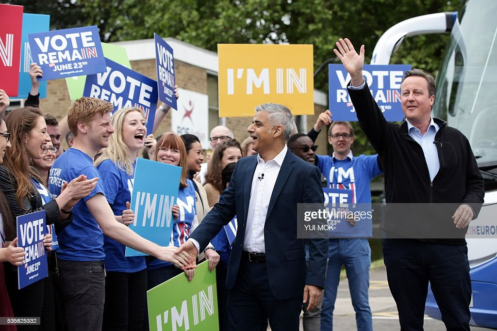 Britain's Prime Minister David Cameron (R) makes a joint appearance with the Mayor of London Sadiq Khan, (Centre L) as they launch the 'Britain Stronger In Europe' guarantee card in west London on May 30, 2016, ahead of the EU referendum in Britain on June 23, 2016. / AFP / POOL / Yui Mok