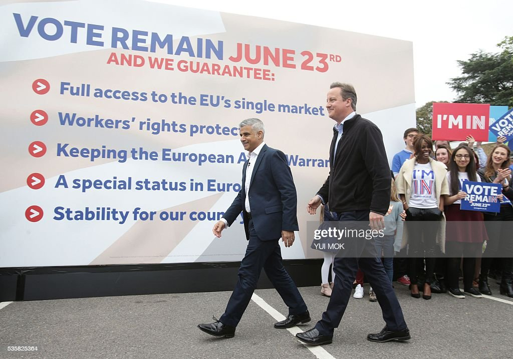 Britain's Prime Minister David Cameron (2nd L) makes a joint appearance with the Mayor of London Sadiq Khan, (L) as they launch the 'Britain Stronger In Europe' guarantee card in west London on May 30, 2016, ahead of the EU referendum in Britain on June 23, 2016. / AFP / POOL / Yui Mok