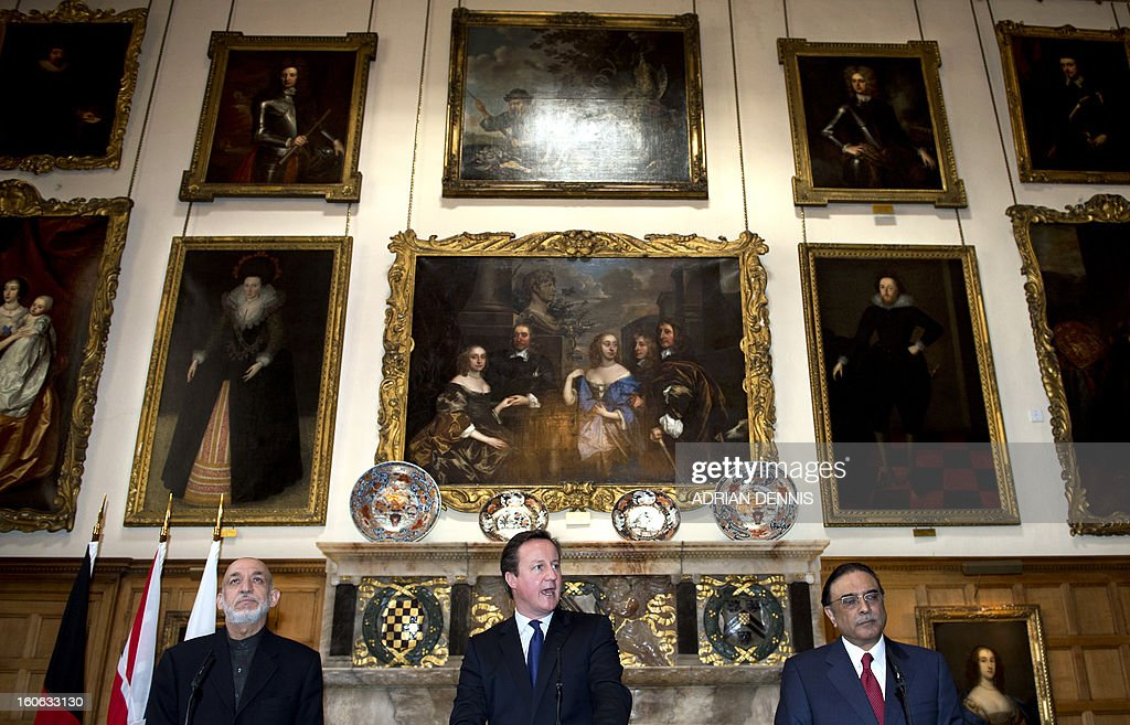 Britain's Prime Minister David Cameron (C) makes a statement alongside Afghan President Hamid Karzai (L) and Pakistani President Asif Ali Zardari (R) at Chequers, the Prime Minister's official country residence, near Aylesbury in Buckinghamshire, west of London, on February 4, 2013. Karzai and Zardari vowed to achieve a peace settlement for Afghanistan within six months, after the talks hosted by Britain.