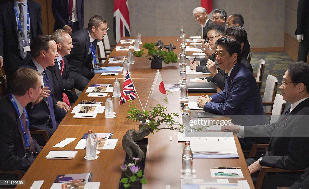 Britain's Prime Minister David Cameron (L) meets with Japanese Prime Minister Shinzo Abe (R) in Ise city, Mie prefecture on May 25, 2016, ahead of the G7 summit. / AFP / JAPAN POOL / STR / Japan OUT / JAPAN