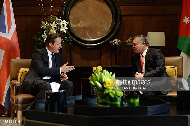 Britain's Prime Minister David Cameron meets with Jordanian King Abdullah II at the Royal Palace in Amman Jordan on September 14 2015 Cameron visited...