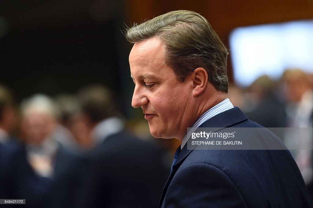 Britain's Prime minister David Cameron reacts as he attends a EU - Summit at the EU headquarters in Brussels on June 28, 2016. Prime Minister David Cameron said today he wants the 'closest possible' relations with the EU after Britain voted to leave the bloc, adding the split should be 'as constructive as possible'. As he arrived at a Brussels summit, Cameron, who is to step down within weeks, told reporters that, while Britain was leaving the EU, 'we mustn't be turning our backs on Europe.' SAKUTIN