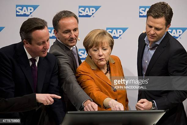 Britain's Prime Minister David Cameron SAP coCEO Jim Hageman Snabe German Chancellor Angela Merkel and manager of the German football team Oliver...