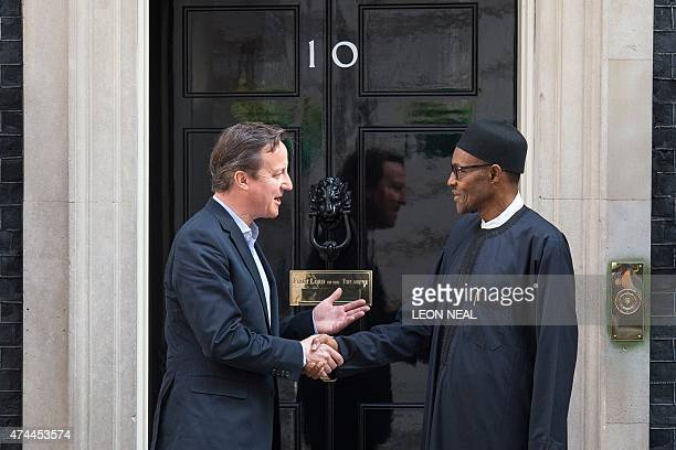 Britain's Prime Minister David Cameron shakes hands with Nigeria's Presidentelect Muhammadu Buhari following a meeting in Downing Street central...