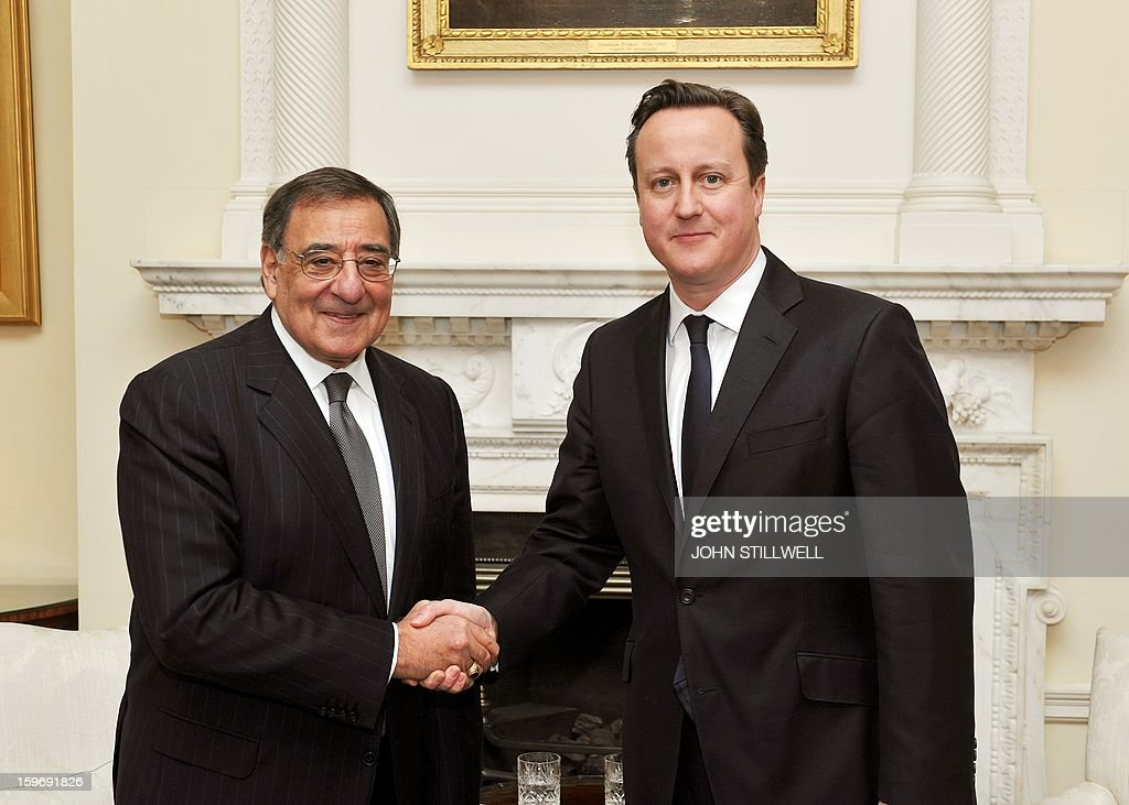 Britain's Prime Minister David Cameron (R) shakes hands with US Secretary of State for Defence Leon Panetta before a meeting at number 10, Downing Street, in central London on January 18, 2013. 'Terrorists' who attack American interests have no place to hide, US Defense Secretary Leon Panetta said as fears grew for dozens of foreigners taken hostage by Islamists at a gas plant in Algeria. AFP PHOTO/POOL/ John Stillwell