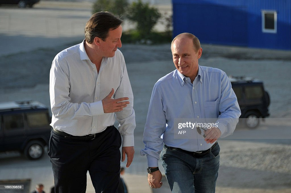 Britain's Prime Minister David Cameron (L) speaks to Russian President Vladimir Putin during a visit to the 2014 Winter Olympic venues after their meeting at the Bocharov Ruchei state residence in Sochi on May 10, 2013. Britain and Russia on May 10 sought to forge a joint approach to the crisis in Syria, as US Secretary of State John Kerry said there was 'strong evidence' Damascus had used chemical weapons against rebels.