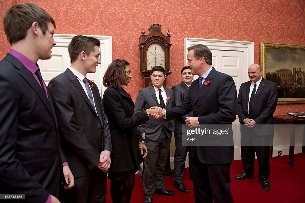 Britain's Prime Minister David Cameron (2-R) speaks with Microsoft apprentices during a meeting with Microsoft CEO Steve Ballmer (R) at 10 Downing Street in London on November 7, 2012. AFP PHOTO/POOL/ Chris Harris