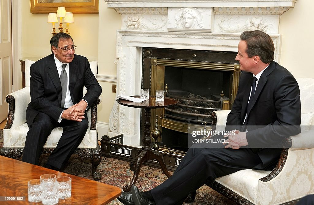 Britain's Prime Minister David Cameron (R) speaks with US Secretary of State for Defence Leon Panetta before a meeting at number 10, Downing Street, in central London on January 18, 2013. 'Terrorists' who attack American interests have no place to hide, US Defense Secretary Leon Panetta said as fears grew for dozens of foreigners taken hostage by Islamists at a gas plant in Algeria. AFP PHOTO/POOL/ John Stillwell