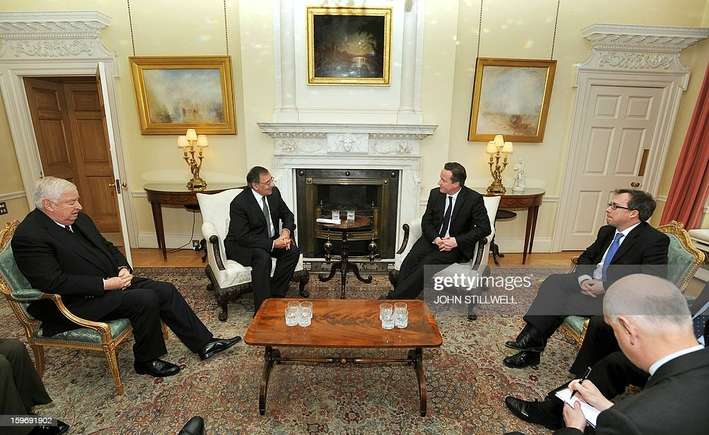 Britain's Prime Minister David Cameron (3-R) speaks with US Secretary of State for Defence Leon Panetta (2-L) before a meeting at number 10, Downing Street, in central London on January 18, 2013. 'Terrorists' who attack American interests have no place to hide, US Defense Secretary Leon Panetta said as fears grew for dozens of foreigners taken hostage by Islamists at a gas plant in Algeria. AFP PHOTO/POOL/ John Stillwell