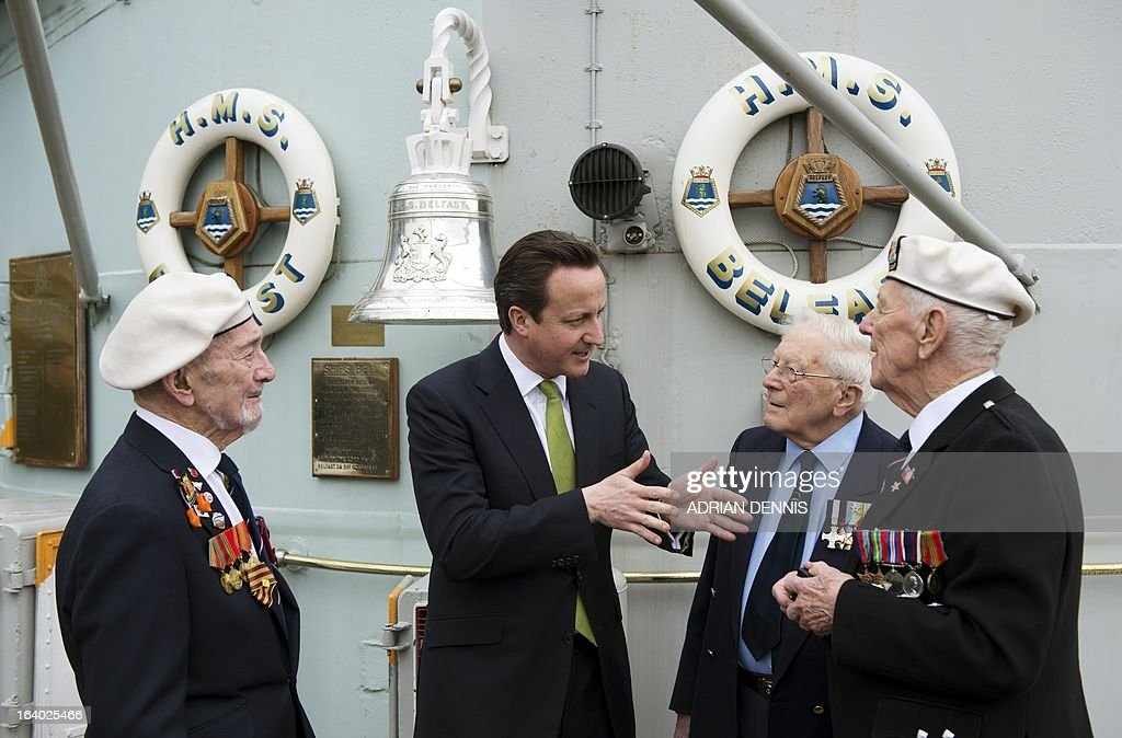 Britain's Prime Minister David Cameron (2L) speaks with WWII veterans Lt Cdr Dick Dykes (2R), Jock Dempster (R) and HMS Belfast veteran Frank Bond (L) on the deck of decommissioned warship HMS Belfast at its mooring on the river Thames in London on March 19, 2013. Cameron hailed the first recipients of the Arctic Star medal as a 'group of heroes', as he presented them with the newly-created award during a ceremony at Downing Street on March 19. The creation of the Arctic Star medal, along with the new Bomber Command Clasp, were announced in December 2012, 67 years after the war, following a long-running campaign. The new Arctic Star rewards World War II war heroes who served on the Arctic Convoys on ships including HMS Belfast on missions to keep open supply lines to Soviet ports from 1941, travelling what Winston Churchill dubbed the 'worst journey in the world'.