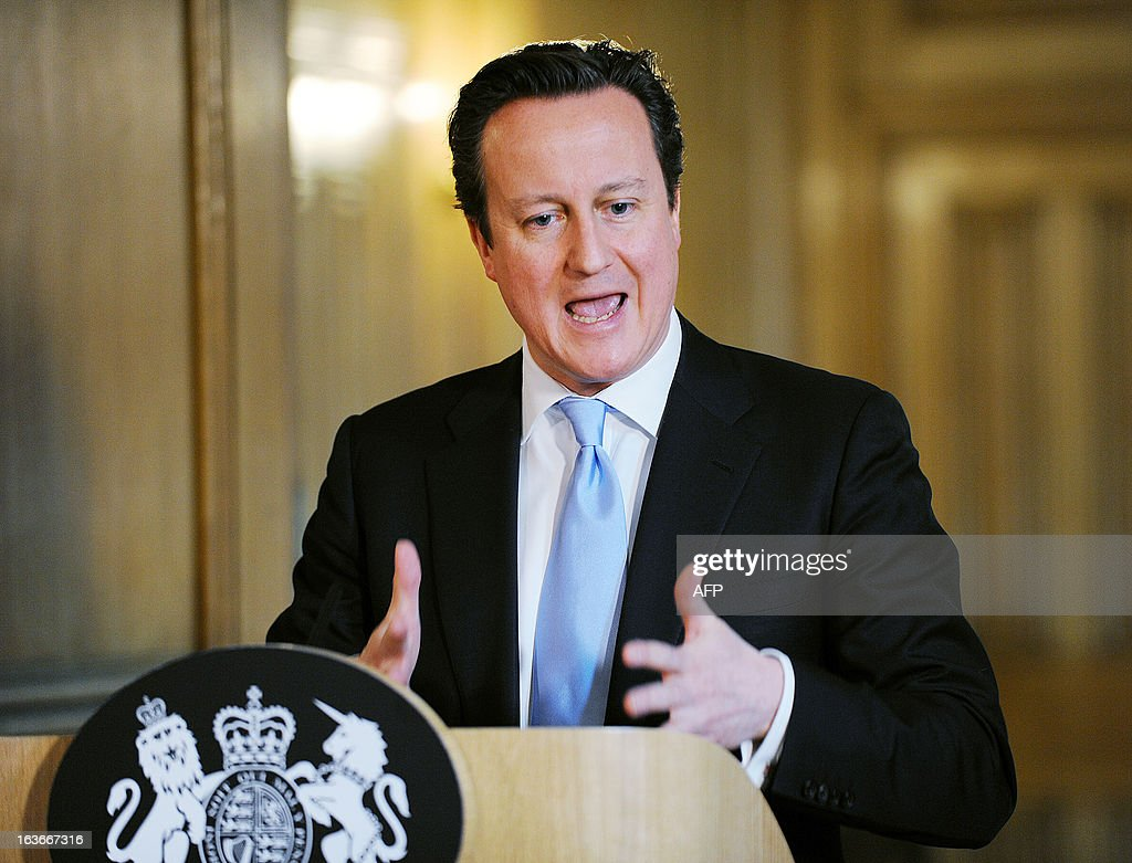 Britain's Prime Minister David Cameron talks during a press conference at 10 Downing Street in London on March 14, 2013, where he made an announcement regarding all-party talks on press regulation. Cameron said on March 14 that all-party talks on press regulation following the phone-hacking scandal had broken down and that lawmakers would vote on a new system next week. The Conservative leader rejected demands from his Liberal Democrat coalition partners and the opposition Labour party for statutory regulation, as recommended last year by the Leveson report into the News of the World hacking scandal.