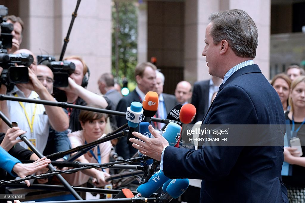 Britain's Prime minister David Cameron talks to the press as he arrives before an EU summit meeting on June 28, 2016 at the European Union headquarters in Brussels on June 28, 2016. / AFP / THIERRY