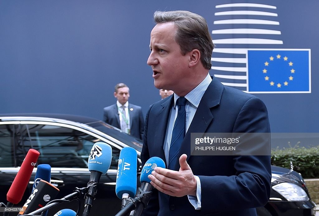 Britain's Prime minister David Cameron talks to the press as he arrives before an EU summit meeting on June 28, 2016 at the European Union headquarters in Brussels. / AFP / PHILIPPE