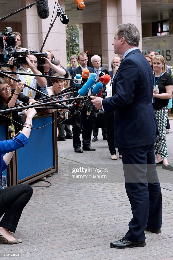 Britain's Prime minister David Cameron talks to the press as he arrives before an EU summit meeting on June 28, 2016 at the European Union headquarters in Brussels. / AFP / THIERRY