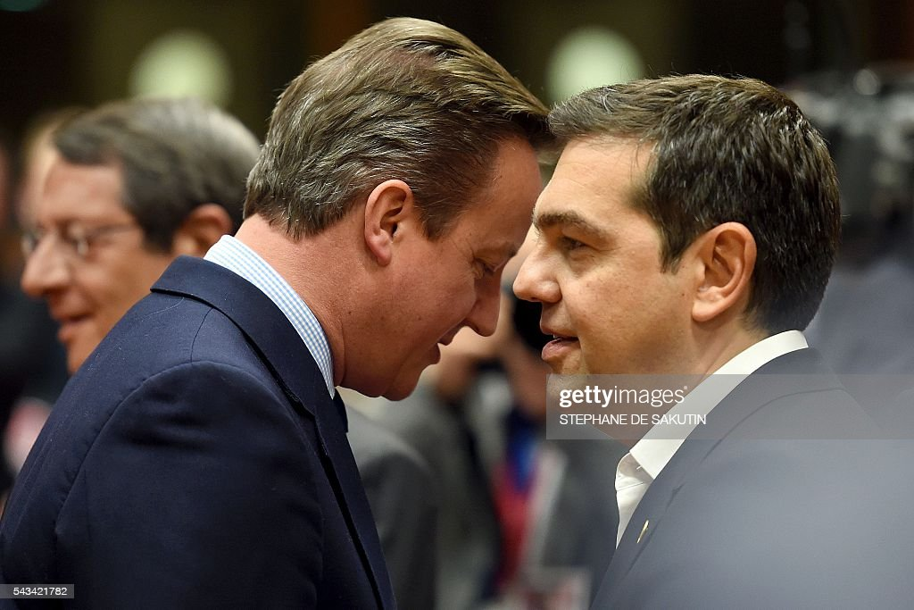 Britain's Prime minister David Cameron (L) talks with Greek Prime Minister Alexis Tsipras (R) during EU - Summit at the EU headquarters in Brussels on June 28, 2016. Prime Minister David Cameron said today he wants the 'closest possible' relations with the EU after Britain voted to leave the bloc, adding the split should be 'as constructive as possible'. As he arrived at a Brussels summit, Cameron, who is to step down within weeks, told reporters that, while Britain was leaving the EU, 'we mustn't be turning our backs on Europe.' SAKUTIN