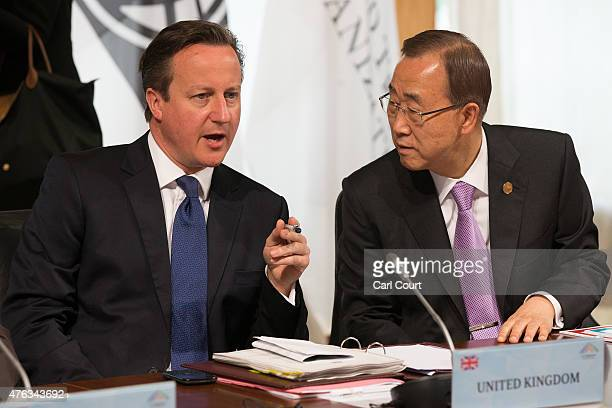 Britain's Prime Minister David Cameron talks with United Nations SecretaryGeneral Ban KiMoon at the beginning of a working session at the summit of...