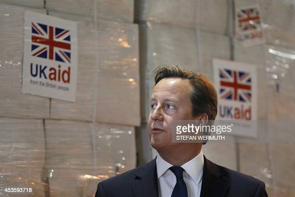 Britain's Prime Minister David Cameron visits a UK Aid Disaster Response Centre where humanitarian supplies are being collected to be airlifted to...
