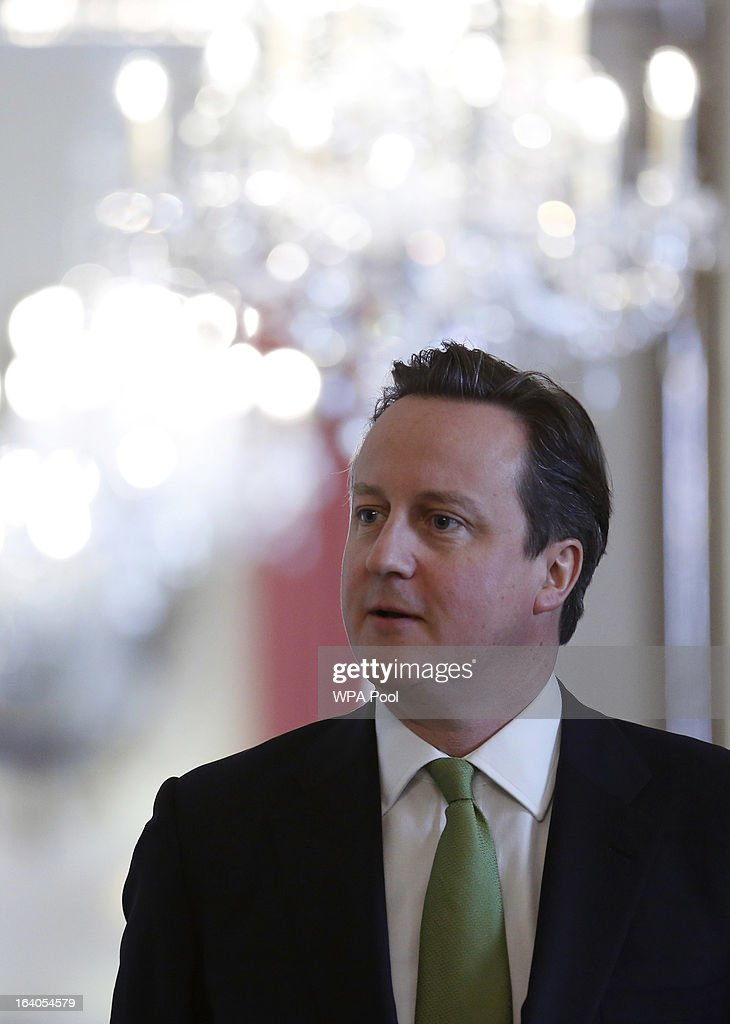 Britain's Prime Minister <a gi-track='captionPersonalityLinkClicked' href=/galleries/search?phrase=David+Cameron+-+Politician&family=editorial&specificpeople=227076 ng-click='$event.stopPropagation()'>David Cameron</a> waits to be introduced at a ceremony to present Bomber Command clasps to World War II veterans at Number 10 Downing Street on March 19, 2013 in London, England. The PM today presented two newly created medals, 68 years after the Second World War ended.