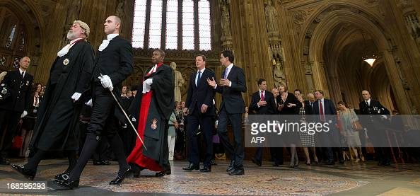 Britain's Prime Minister David Cameron walks with the Leader of the Opposition Ed Milliband and other lawmakers from the House of Commons walk...