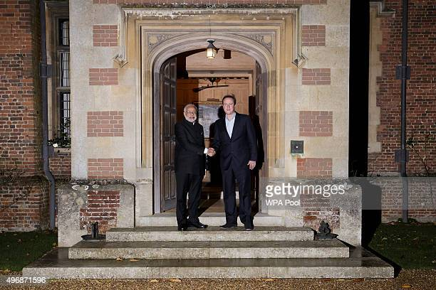 Britain's Prime Minister David Cameron welcomes Indian Prime Minister Narendra Modi to his official residence Chequers during an official three day...