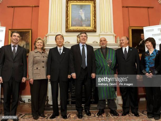 MORATINOS Britain's Prime Minister Gordon Brown poses with Anders Fogh Rasmussen Hillary Clinton Ban Ki Moon Afghan President Hamid Karzai Aga Khan...