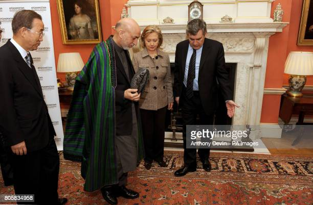 Britain's Prime Minister Gordon Brown poses with Hillary Clinton Afghan President Hamid Karzai and Ban Ki Moon inside 10 Downing Street ahead of the...