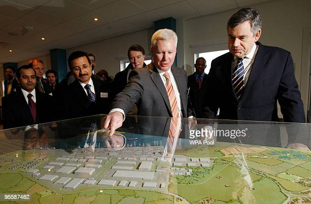 Britain's Prime Minister Gordon Brown views a scale model of the DP World London Gateway with CEO London Gateway Simon Moore DP World chairman Sultan...