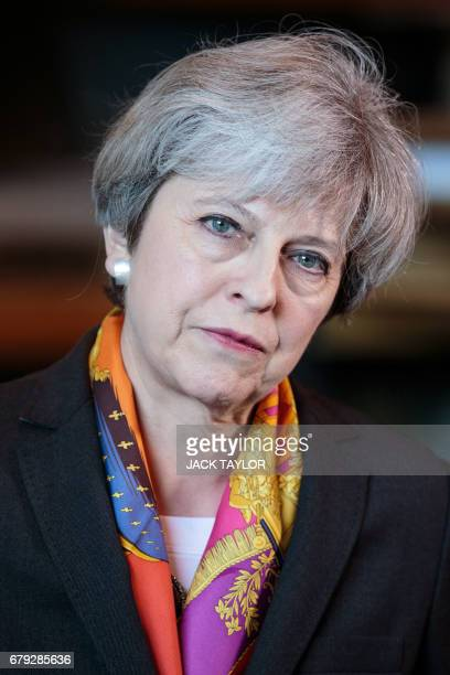 Britain's Prime Minister Theresa May addresses the media at the end of her tour of the Octink sign manufacturer factory in Brentford west London on...