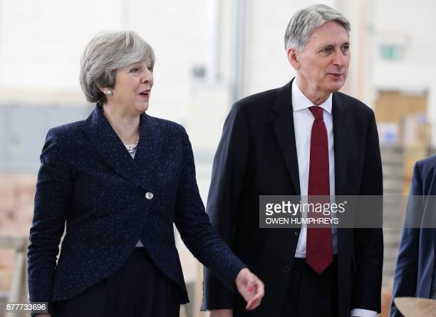 Britain's Prime Minister Theresa May and Britain's Chancellor of the Exchequer Philip Hammond visit to Leeds College of Building a specialist further...