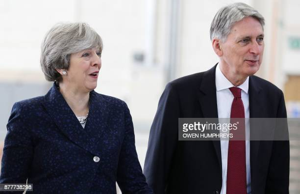 Britain's Prime Minister Theresa May and Britain's Chancellor of the Exchequer Philip Hammond visit Leeds College of Building a specialist further...