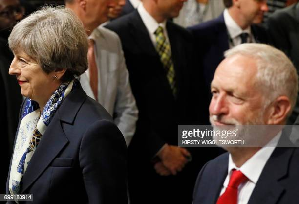 Britain's Prime Minister Theresa May and Britain's opposition Labour party Leader Jeremy Corbyn walk through the House of Commons towards the House...