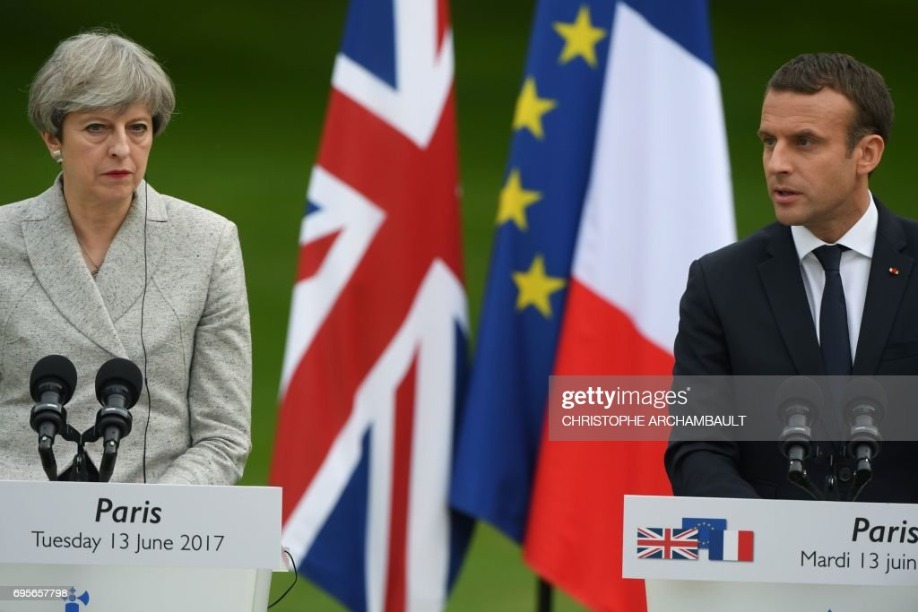 Britain's Prime Minister Theresa May (L) and France's President Emmanuel Macron hold a joint press conference in the grounds of The Elysee Palace in Paris on June 13, 2017. /