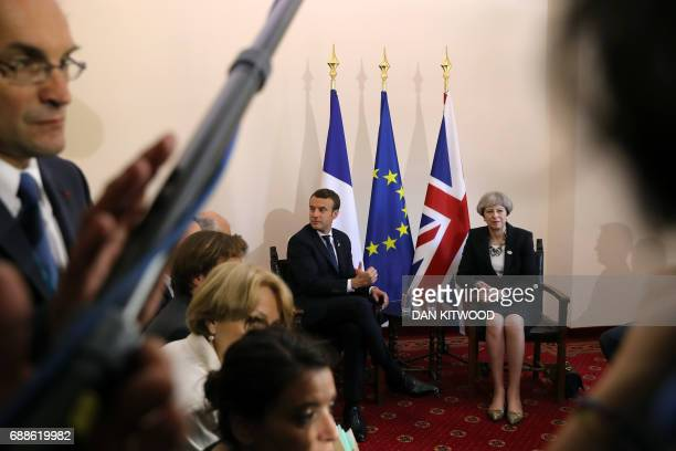 Britain's Prime Minister Theresa May and French President Emmanuel Macron have taken seat for a bilateral meeting at the Summit of the Heads of State...
