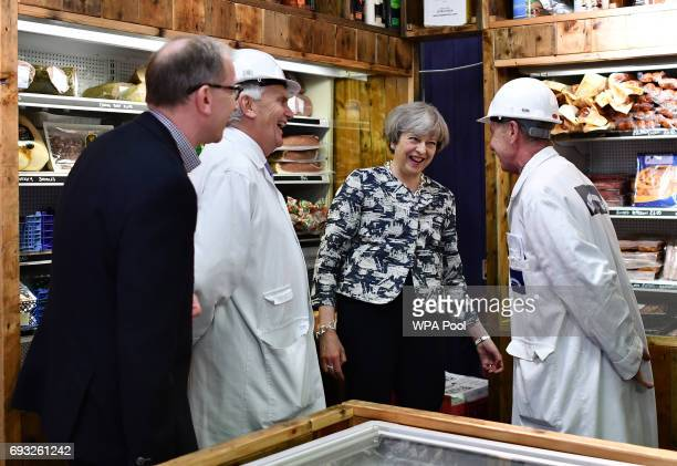Britain's Prime Minister Theresa May and her husband Philip visit Smithfield Market during a Conservative Party general election campaign visit on...