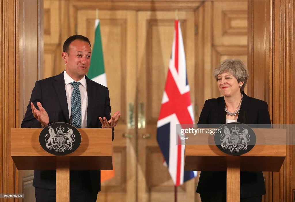 Britain's Prime Minister Theresa May (R) and Irish Taoiseach Leo Varadkar (L) speak at a joint press conference after talks at 10 Downing Street in London on June 19, 2017. Brexit negotiations start in Brussels today. Working groups will be set up to focus on three key areas, which include the future of the Northern Irish border with EU member Ireland. PHOTO / POOL / Philip TOSCANO