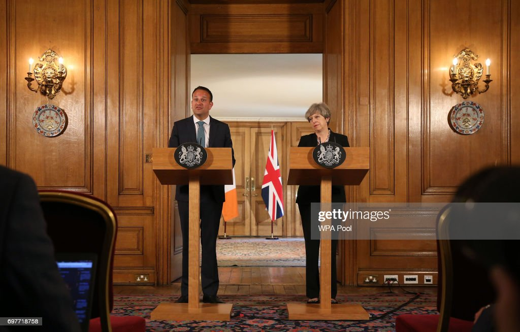 Britain's Prime Minister Theresa May (R) and Irish Taoiseach Leo Varadkar shake hands at a joint press conference after talks at 10 Downing Street on June 19, 2017 in London, England. The new Irish Taoiseach said he had been reassured about a potential deal between the Conservative Party and the Democratic Unionist Party (DUP) after raising concerns about the deal with the Prime Minister.