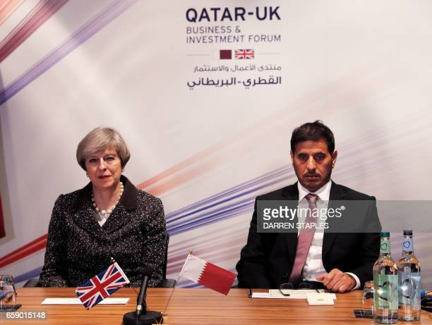 Britain's Prime Minister Theresa May and Qatar's Prime Minister Sheikh Abdullah bin Nasser bin Khalifa attend the QatarUK Business and Investment...