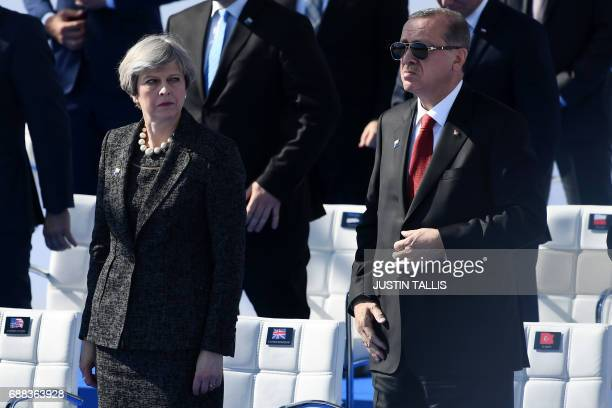 Britain's Prime Minister Theresa May and Turkish President Recep Tayyip Erdogan look on during the NATO summit ceremony at the NATO headquarters in...