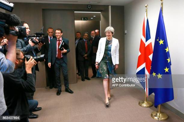 Britain's Prime Minister Theresa May arrives at a bilateral meeting with European council president on the second day of a summit of European Union...