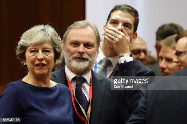 Britain's Prime Minister Theresa May arrives for a round table meeting on October 19 2017 in Brussels Belgium Under discussion are the Iran Nuclear...