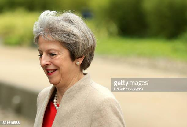 Britain's Prime Minister Theresa May arrives for the BBC One Question Time Leaders Special to be moderated by David Dimbleby and broadcast live from...