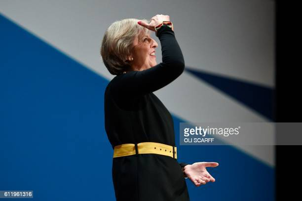 Britain's Prime Minister Theresa May arrives on stage to deliver her speech on the first day of the Conservative party annual conference at the...