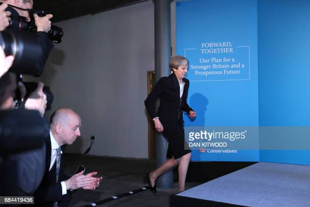 Britain's Prime Minister Theresa May arrives on stage to launch the Conservative Party general election manifesto in Halifax in northern England on...