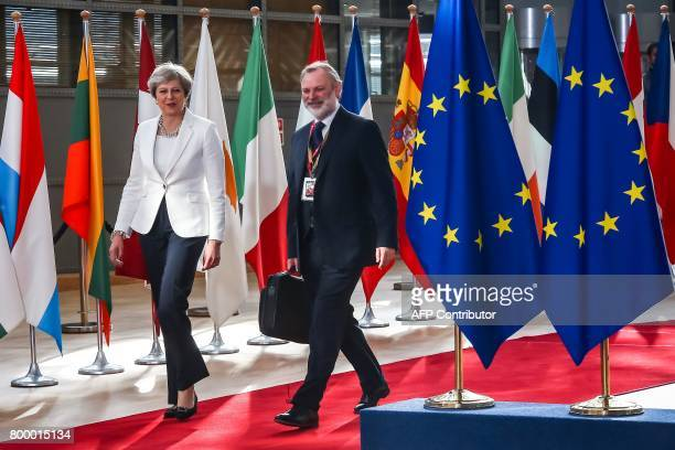Britain's Prime Minister Theresa May arrives on the second day of a summit of European Union leaders and focusing on globalisation and migration...