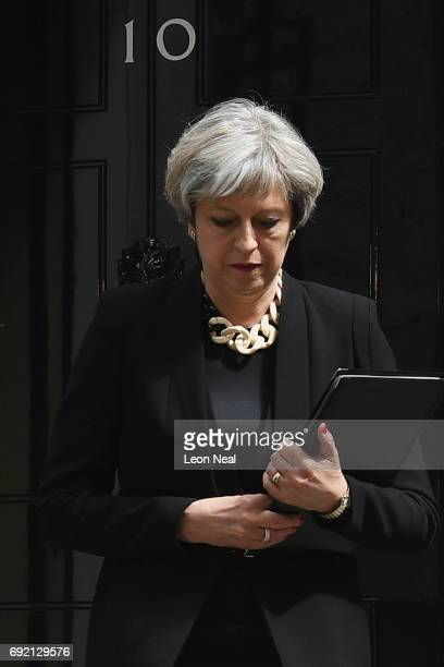 Britain's Prime Minister Theresa May arrives to address the media as she makes a statement following a COBRA meeting in response to last night's...