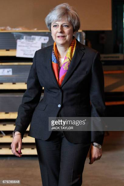 Britain's Prime Minister Theresa May arrives to address the media at the end of her tour of the Octink sign manufacturer factory in Brentford west...