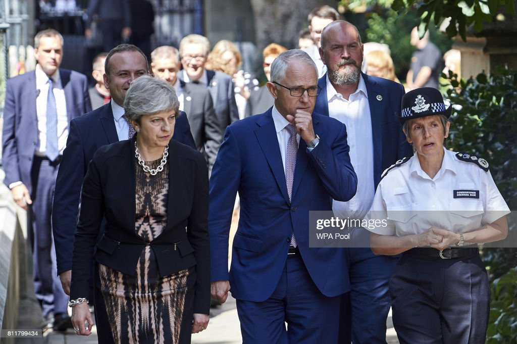 Britain's Prime Minister Theresa May (L), Australian Prime Minister, Malcolm Turnbull (C) and Metropolitan Police Commissioner Cressida Dick (R) arrive to speak to first responders from the emergency services outside Southwark cathedral during a visit to the Borough Market area of London on July 10, 2017 in London, England. Seven people were killed, two of them Australian, in a terror attack in the British capital on June 3, 2017, when a van smashed into pedestrians on London Bridge before three assailants went on a stabbing spree.