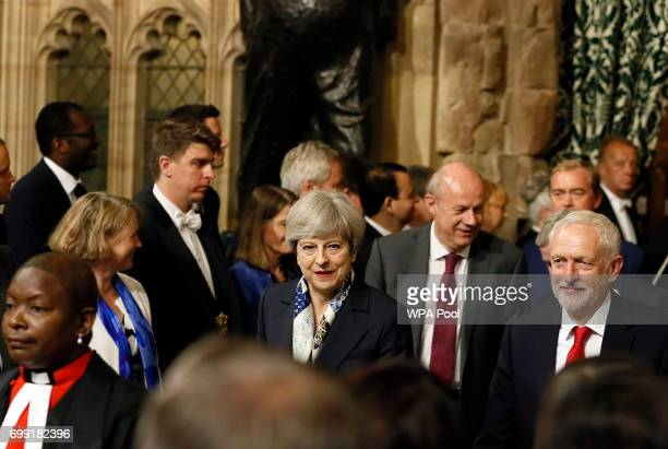 Britain's Prime Minister Theresa May centre and leader of the opposition Jeremy Corbyn right walk through the House of Commons to attend the state...